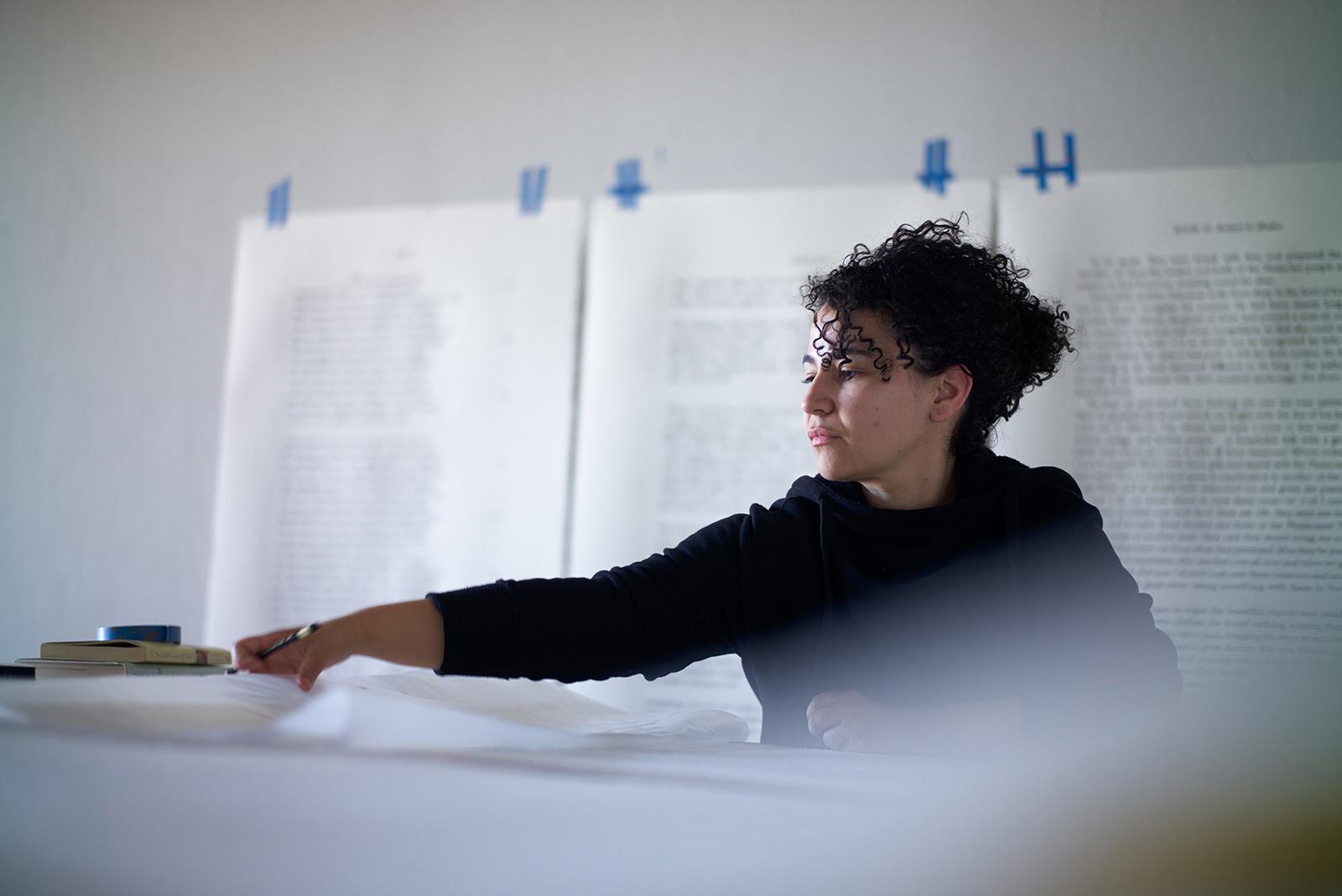 Artist Bethany Collins working in her studio